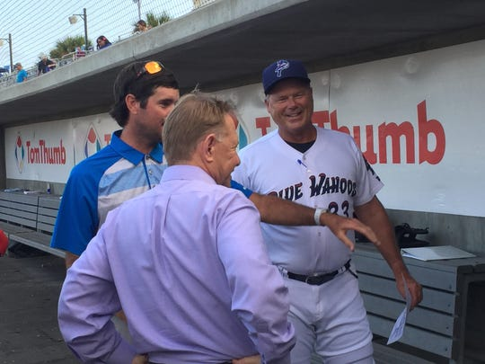 Bubba Watson, Quint Studer and Pat Kelly chat in the dugout before a game last season at Blue Wahoos Stadium. Studer and Watson will be together Monday at the Baseball Winter Meetings.