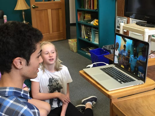 Students at the Endeavour Middle School in Shelburne on a Skype session with their peers in Uganda.