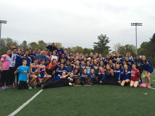 Saugatuck's boys and girls track teams celebrate the regional titles they won May 20.