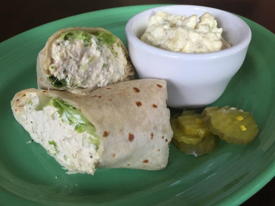 A tuna salad wrap comes with choice of coleslaw, fries or, as here, potato salad.