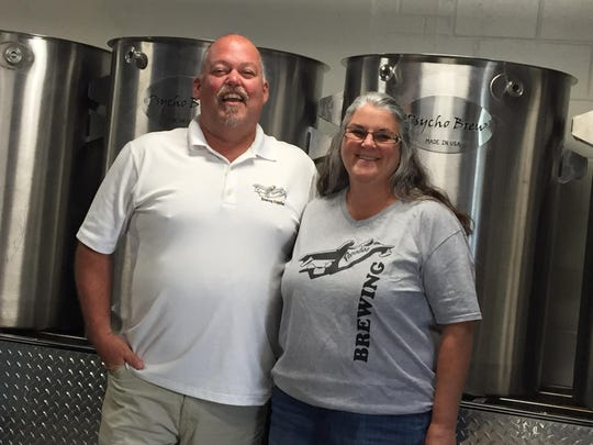 Jeff and Tammy Graff in their newly expanded brew house at Paradise Brewing in Anderson Township.