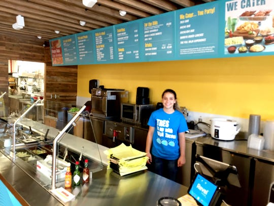 Server Katlynn Outten works at the new westside Taco del Mar at 1900 4th St. N.E.