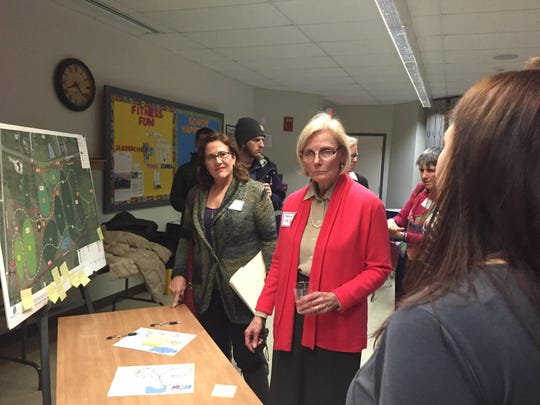 Karen Whitby, left, and Helen Riehle, look over plans for the Underwood Property in January 2015 at South Burlington City Hall.