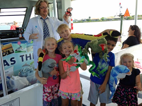 Glen Beitmen gives a science lesson to his young students on the cruise.
