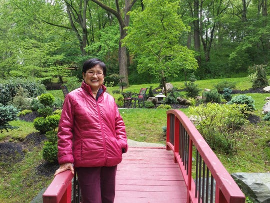 Chen's property is smaller than it appears so she relies on views from the nearby woods.