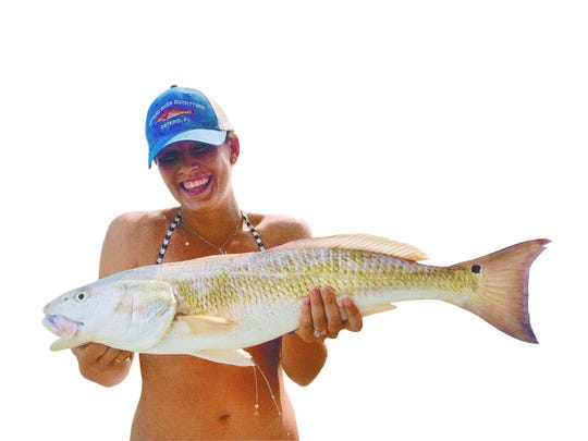Estero River Outfitters pro-staff angler Kristen Stuller used a live pinfish on last Thursday's outgoing tide in New Pass to hook this upper-slot-size redfish, while fishing with Get Hooked Charters Capt. Matt DeAngelis.