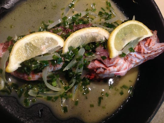 Lionfish stuffed with onion, butter, thyme, white wine, lemon, chives and garlic