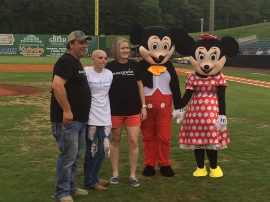 Morgan Fuller, second from left, her Make-A-Wish sponsors Cliff Carter and Kendra Street along with Mickey and Minnie Mouse pose for a photo on the field at The Ballpark at Jackson after Fuller's wish was granted before the Jackson Generals played the Montgomery Biscuits on July 9. Fuller plans to help other people have their wishes granted.