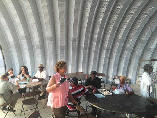 Left: A community engagement meeting last month allowed people a look inside two Quonset huts on Grand River.