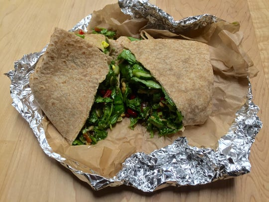 A Minden Inn wrap at Chomp salads is stuffed with spinach, cucumber, hard-cooked egg, goji berries and other ingredients. Salads can be ordered tossed, chopped or wrapped.