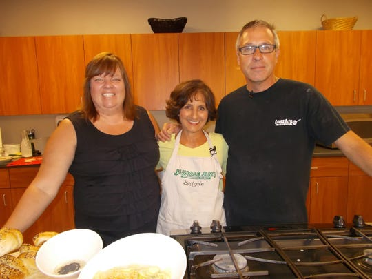 Monica Lippmeier, Rita and Laszlo Molnar cook up chicken paprikash
