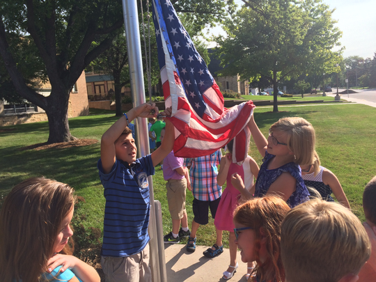 The third-grade students at St. Margaret Mary Elementary School learned flag etiquette including the parts of the flag, proper folding techniques, how to raise the flag and how to properly care for the American flag. Pictured with the flag are Mason Uhlenbrauck (left) and Bethany Ruppert.