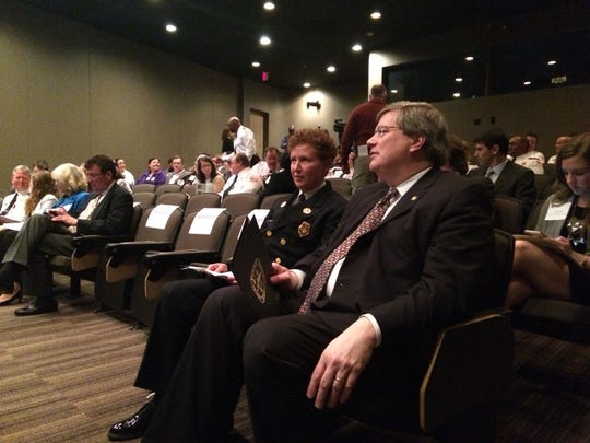 In February, Memphis Mayor Jim Strickland (right) and Fire Services Director Gina Sweat greeted IBM consultants who studied how the city can reduce non-emergency ambulance calls. (Ryan Poe/The Commercial Appeal)