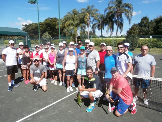 It's all smiles for tennis pros and participants of