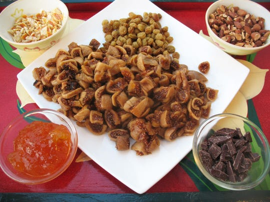 Dried fruits, nuts, chocolate and marmalade make up the filling for Cucidati.