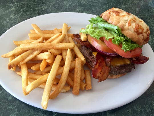 The XL burger at Bully's No. 1 offers classic fixings and a pillowy baked cheese bun.