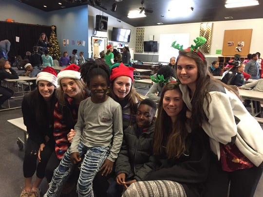 Tatnall students Juliana Campbell, from left, Emily Zuleba, Maddie Hoban, Sam Steblai and Sam Hutchinson helped the Dagsboro Boys & Girls Club members pick holiday gifts for their family members.