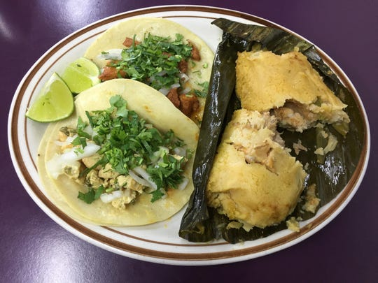 A DIY combination plate at Restaurante Yesenia features a chicken taco, a marinated pork taco, and a creamy, savory chicken tamale cooked in a banana leaf.
