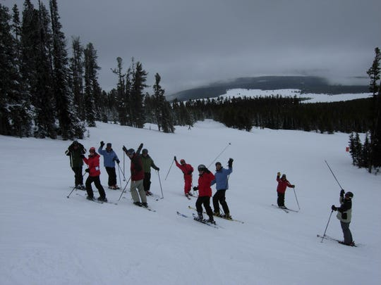 Instructors and students in a recent Peak Performance adult skiing class take a break to mug for the camera.
