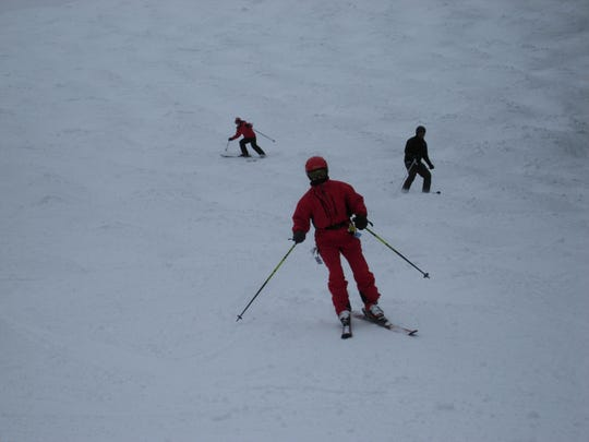 Red-clad Mary Frank leads the pack a few years ago in a Peak Performance adult ski class at Showdown Montana.