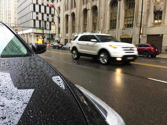 Freezing rain overnight paired with rising temperatures Tuesday morning created slick, icy roads covered with water, according to the National Weather Service in White Lake Township.