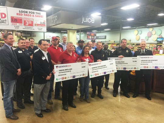 Brookshire Grocery Co. presents funds raised from the inaugural Heroes Run.