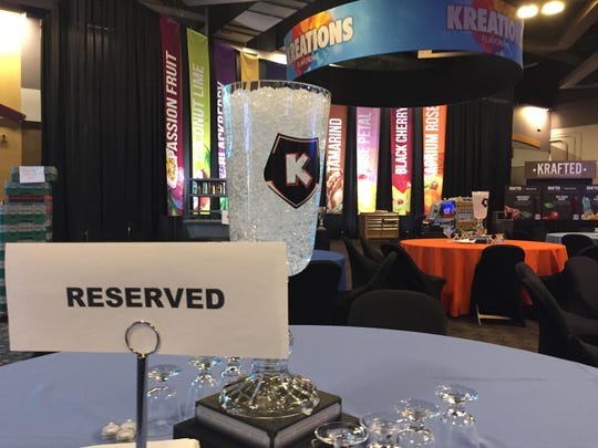 Buckets of ice and goblets occupy a center spot on tables at Kona Ice's national convention in Covington for franchise owners to taste new flavors.