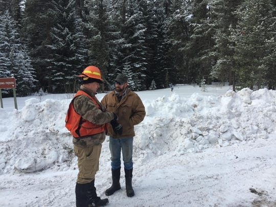 Tim Seidel, timber sale administrator for Helena-Lewis and Clark National Forest, speaks to Nate Johnson, an operator for Salmon River Wood in Missoula.