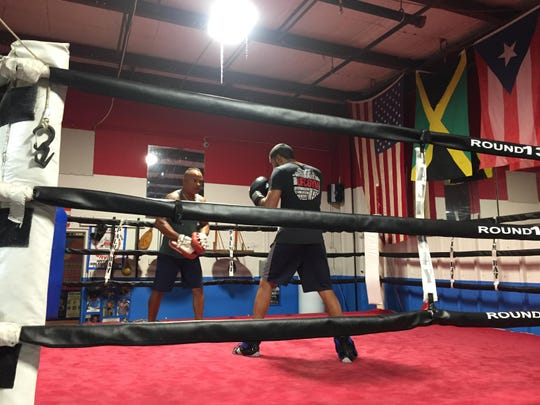 Boxing coach Johnny Hernandez trains Miguel Cruz of
