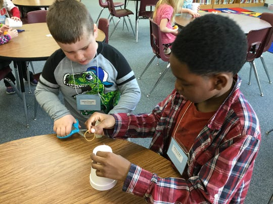 Hoover students Ashton Clumpner, left, and Marvin Walker at the school's STEAM day Feb. 3. The event was organized by Neenah High School Project Lead the Way students, who designed a series of games and activities.