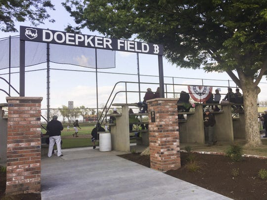 Golden West High School dedicated a new memorial entrance to honor the late Dick Doepker before Thursday's West Yosemite League baseball game against Mt. Whitney. Doepker served as the Golden West principal from 1980-1996.
