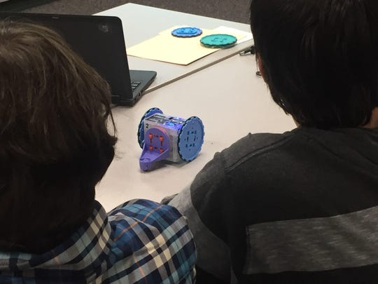 Making the robot complete the assigned task requires math skills and problem solving. Cameron Tegenkamp and Alan Marlow, eighth-graders at White Oak Middle School, showed their skills to school board members.