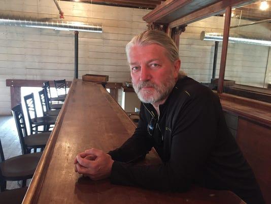 lead art Mark Tronson at bar
