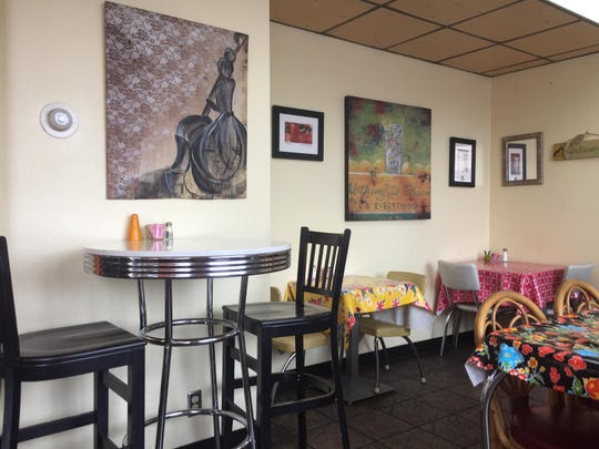 Works by local artists garnishes the walls of the dining room at Dish Café.