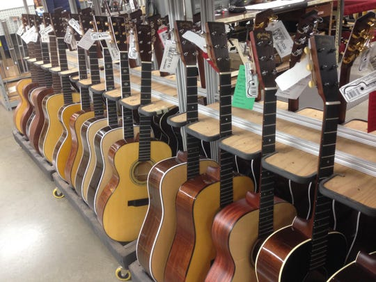 A rack of guitars ready to be stringed.