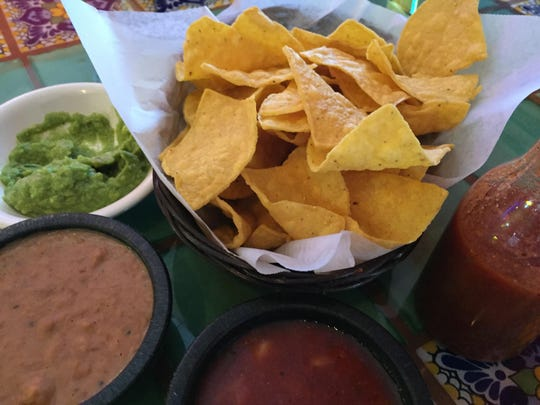 Guacamole, warm refried beans and salsa with a hint of heat accompany a basket of chips at Casa Grande 2.