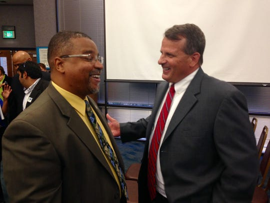 That was then: Palm Bay City Manager Gregg Lynk, right, and Mayor William Capote chat after an April 14, 2015, city council meeting. Capote recently asked Lynk in a letter to resign, while council members will seek an independent legal opinion as to whether Capote violated city charter or misused the city's corporate seal by writing the letter.