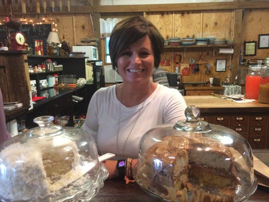 The store's new owner, Tana Pitt, works in the kitchen area during grand reopening festivities on Friday.
