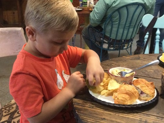 Bram Oliver, 4, chows down during lunch at the cafe.