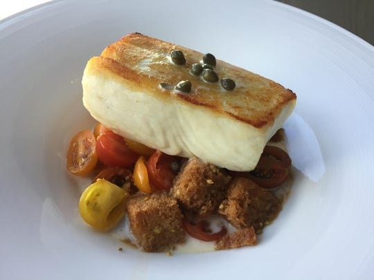 At the Shore Room restaurant in the Renaissance Reno hotel, Alaskan halibut strikes a pose atop a panzanella bread salad that soaks up the essence of the fish.