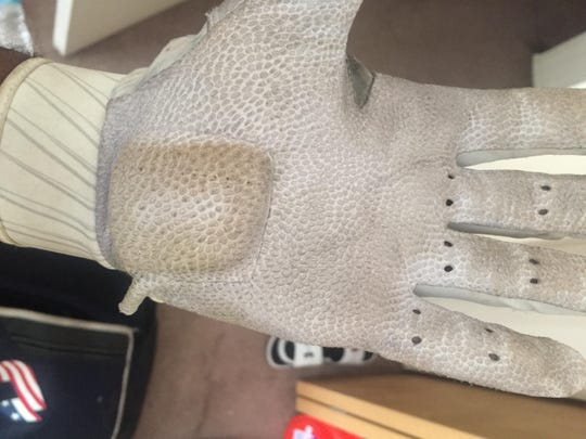 A glove worn by Michigan second baseman featured extra