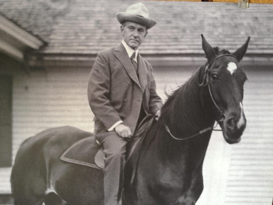 A photo at the President Calvin Coolidge State Historic Site shows Coolidge on a horse.