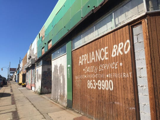 Mainly vacant storefronts on the McNichols corridor in Detroit.