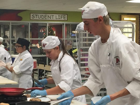 Neenah High School culinary students Nikki Messick, left, and Jacob Solis, won a gold award at the Fox Valley Technical College High School Throwdown.