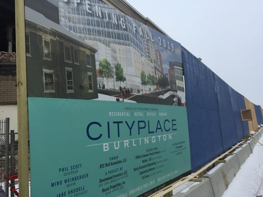 A sign outside the construction zone for City Place, seen on Jan. 3, 2018, the development replacing the Burlington Town Center mall in downtown Burlington, presents what the finished building might look like.