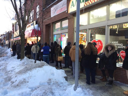 By 7a.m. Tuesday, a crowd had lined up at the New Palace Bakery in Hamtramck to get the sweet treat synonymous with Fat Tuesday in Metro Detroit.