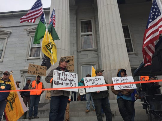 Pro-gun activists rally outside the Statehouse on April 14, vowing to unseat elected officials who approved a package of gun control measures earlier this year.