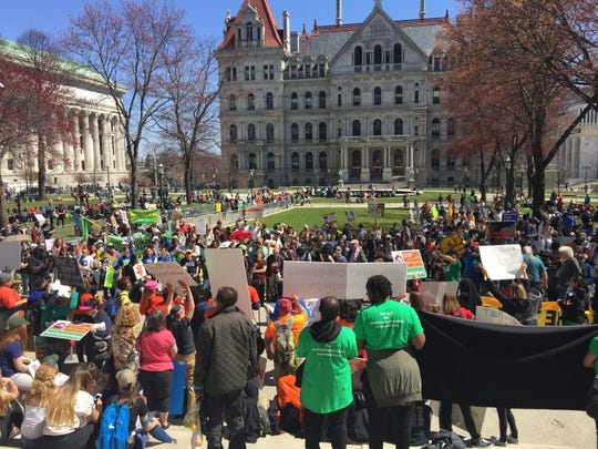 Demonstrators rally April 23 in Albany to demand action on climate change.