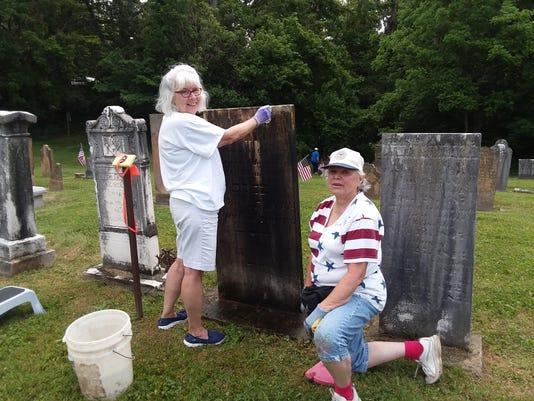 Underhill & Kearton clean T. Rose headstone