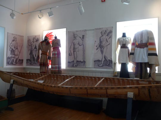 Eighteenth and 19th century Abenaki outfits from the Frederick M. Wiseman Collection on view at Lake Champlain Maritime Museum in 2016. Low light levels help prevent damage to fragile textiles.